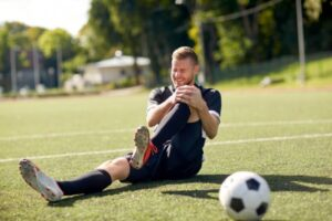 depositphotos_141032930-stock-photo-injured-soccer-player-with-ball